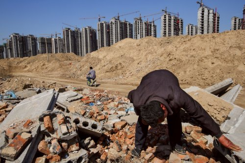 Photo Credit: New York Times. China flattens mountains for economic development.